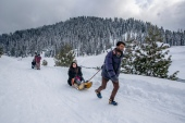 Tourists again fill Gulmarg's hotels, and ski, sledge and trek its Himalayan landscape. [Dar Yasin/AP Photo]