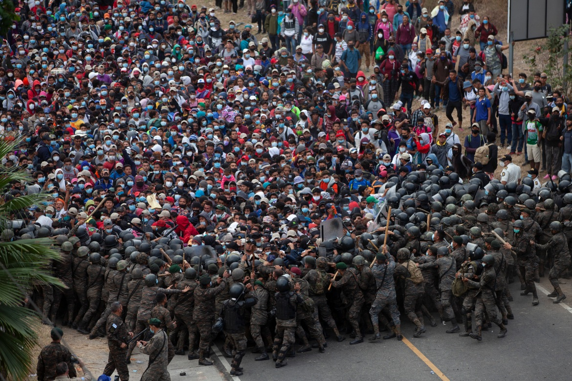 Guatemalan security forces used batons and tear gas to beat back a large migrant caravan bound for the US. [Sandra Sebastian/AP Photo]
