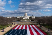 A large American Flag is placed on the National Mall, with the US Capitol behind, ahead of the inauguration of President-elect Joe Biden and Vice President-elect Kamala Harris, January 18, 2021 [Alex Brandon/AP Photo]