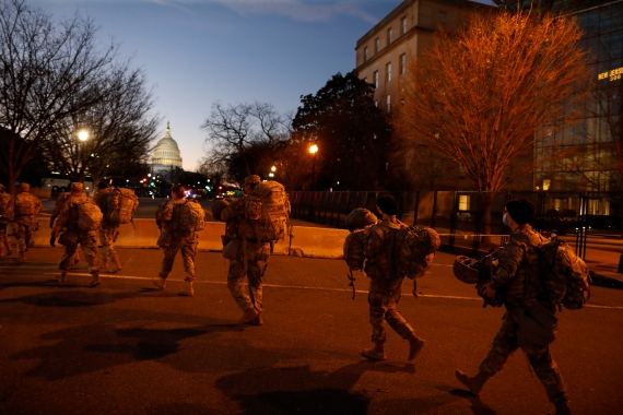 National Guard troops are deployed throughout Washington, DC in the most heavily guarded inauguration since that of President Abraham Lincoln in 1861. [Rebecca Blackwell/AP Photo]