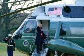 President Donald Trump gestures as he boards Marine One on the South Lawn of the White House, leaving the grounds for the final time in his term [Alex Brandon/The Associated Press]