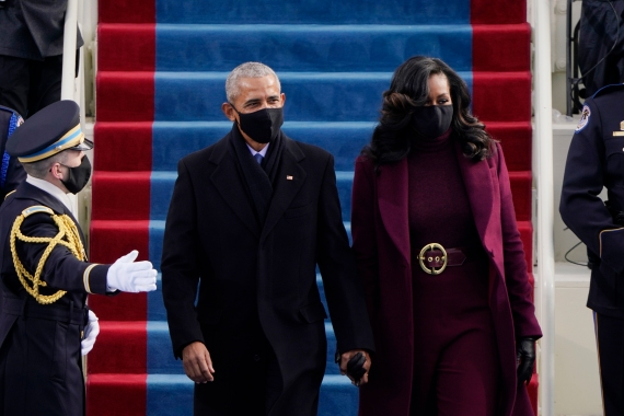 Former President Barack Obama and his wife Michelle arrive for the 59th Presidential Inauguration at the US Capitol for President-elect Joe Biden. [Patrick Semansky/POOL/AP Photo]