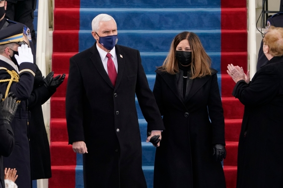 Vice President Mike Pence and his wife Karen, arrive for the 59th Presidential Inauguration at the US Capitol for President-elect Joe Biden in Washington. [Patrick Semansky/Pool/AP Photo]