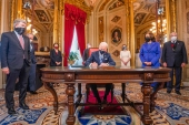 President Joe Biden signs three documents including an inauguration declaration, cabinet nominations and sub-cabinet nominations in the President's Room at the US Capitol after the inauguration ceremony [Jim Lo Scalzo/The Associated Press]