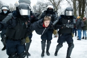 Police detain a man during a protest against the jailing of Alexei Navalny in St Petersburg [Dmitri Lovetsky/AP Photo]