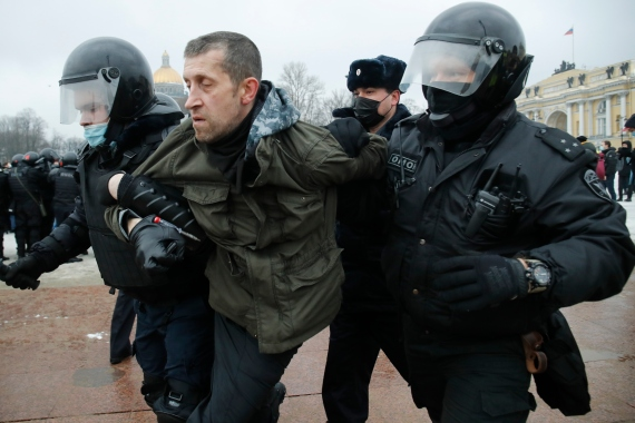 Security forces detain a man during the protest in St Petersburg. [Dmitri Lovetsky/AP Photo]