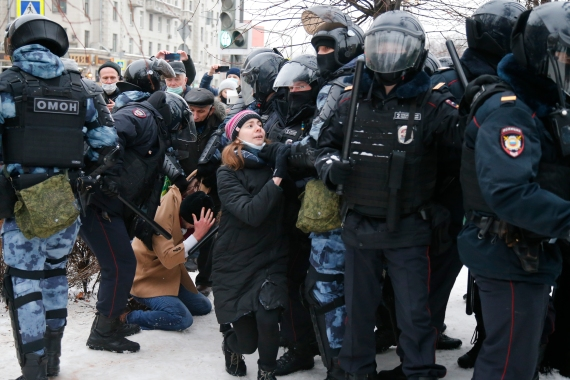 Police detain a man during a protest against the jailing of Alexei Navalny in Moscow [Alexander Zemlianichenko/AP Photo]
