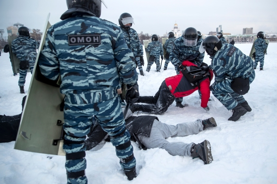 Police detain demonstrators at a rally in Yekaterinburg. [Anton Basanayev/AP Photo]