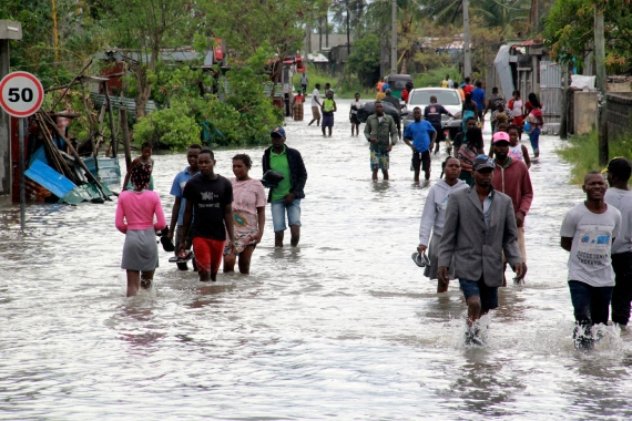 People make their way through floodwaters in Beira. The Mozambican port city breathed a sigh of relief on Saturday as Cyclone Eloise caused less damage than feared as it passed through. [AP Photo]