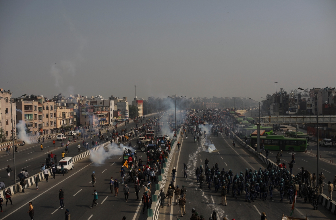 Police use tear gas to disperse farmers who marched to the capital during India's Republic Day celebrations. [Altaf Qadri/AP Photo]