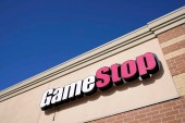 A GameStop sign is seen above a store on January 28, 2021, in Urbandale, Iowa [AP/Charlie Neibergall]