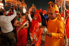 An Indian brass band plays as they accompany a wedding procession in New Delhi [File: Manish Swarup/AP]