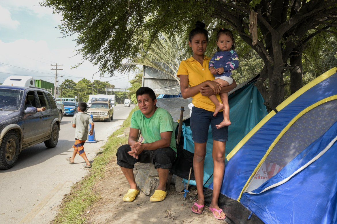 'The noise from the passing cars is constant. At first, we couldn't sleep, but we have gotten used to the noise,' said 18-year-old Dina Ester Corea Lopez, who stays in her small tent with her 18-month-old daughter, Alexandra. [Christian Jepsen/NRC]