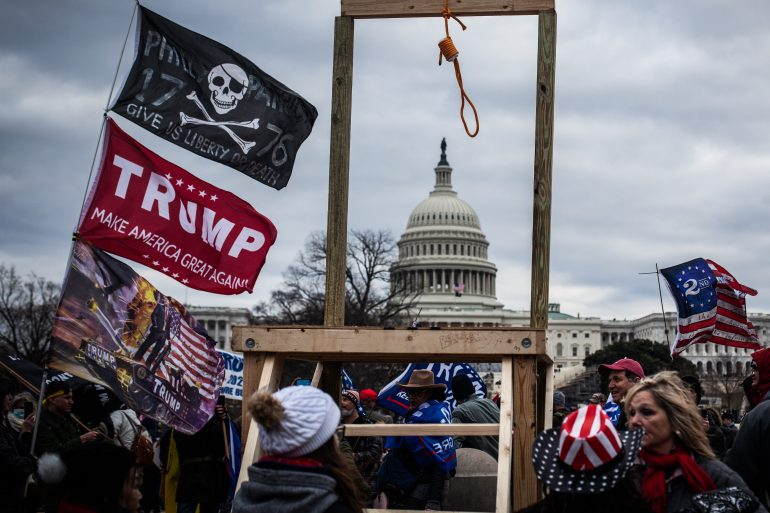 Trump supporters near the US Capitol, on January 6, 2021. Trump faces a Senate trial for 'inciting' the protesters who stormed the historic building [Shay Horse/NurPhoto via Getty Images]