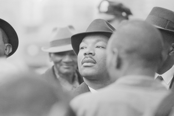Dr Martin Luther King, Jr stands with fellow demonstrators as they are arrested for parading without a permit in Selma, Alabama in 1965 [Getty Images]
