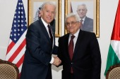 Then-US Vice President Joe Biden and Palestinian President Mahmoud Abbas shake hands during their meeting at the presidential compound on March 10, 2010 in Ramallah, West Bank [Thaer Ganaim/PPO via Getty Images]