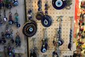 Evil-eye amulets, or nazarliks, hang in a gift shop in Turkey's capital Ankara [Andrew Wilks/Al Jazeera]
