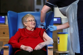 Annie Innes, 90, receives the Pfizer-BioNTech COVID-19 vaccine at the Abercorn House Care Home in Hamilton, Scotland, on December 14, 2020 [Russell Cheyne/Reuters/Pool]
