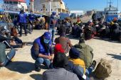 The IOM posted photographs on Twitter showing its staff members speaking with mostly African male migrants on a Libyan pier [Twitter Image IOM]