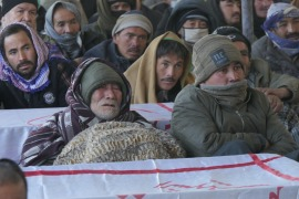 Since the attack, the relatives of those killed placed their coffins on a highway in Quetta and refused to bury the dead until the killers were apprehended and Khan came to meet them [Saadullah Akhtar/Al Jazeera]