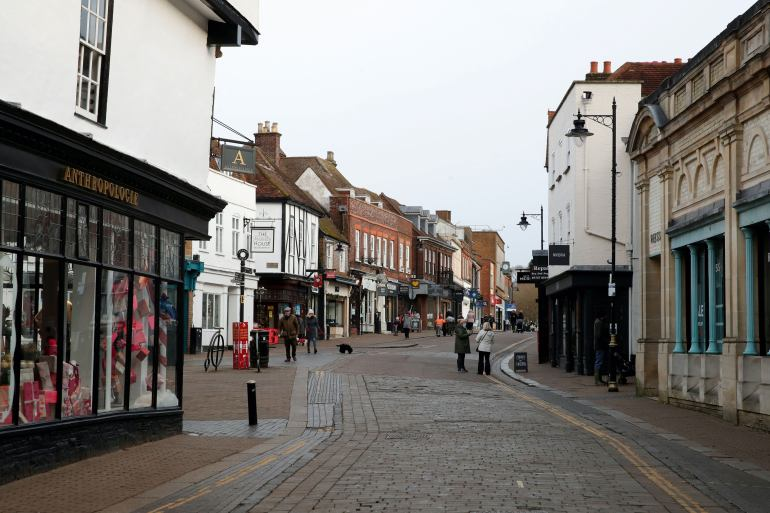 The high street in St Albans is deserted amid the United Kingdom's strict coronavirus lockdown, which officials expect will last for weeks [File: Matthew Childs/Reuters]
