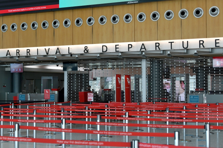 An empty arrivals and departures security point at the Qantas terminal at Sydney Airport. Australia says it may keep its borders close throughout 2021 even as it rolls out vaccinations [File: Bianca de Marchi/EPA]