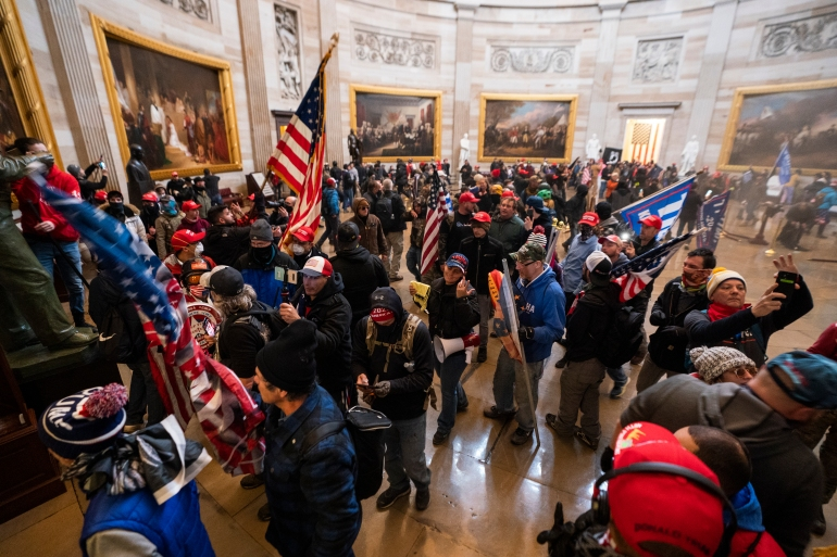 Supporters of US President Donald Trump in the Capitol Rotunda after breaching security on January 6 [File: Jim Lo Scalzo/EPA-EFE]