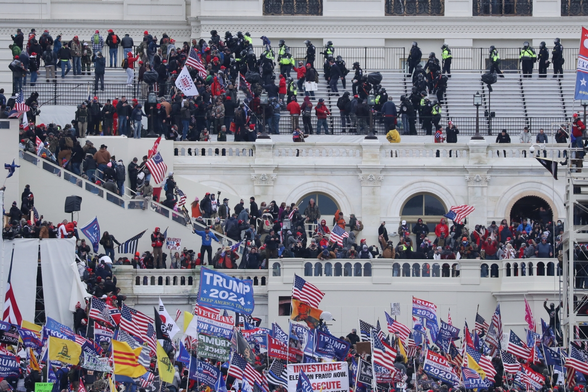 Trump protesters occupy the grounds of the West Front of the US Capitol, including the inaugural stage and viewing stands, in Washington. [MICHAEL REYNOLDS/EPA]