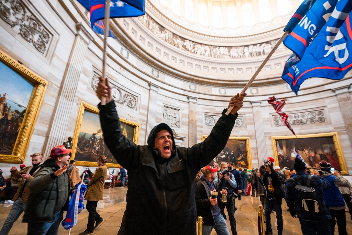 Protesters celebrate in the Capitol Rotunda after breaching Capitol security. [Jim Lo Scalzo/EPA]