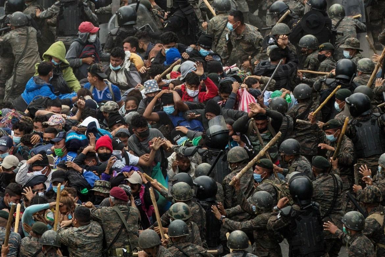 Guatemalan security forces surround the migrant caravan on a road near the border with Honduras. [Esteban Biba/EPA]