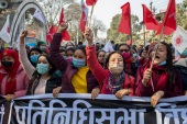 Members of Nepal's Communist party protest against Oli in the capital Kathmandu on January 22, 2021 [Narendra Shrestha/EPA]