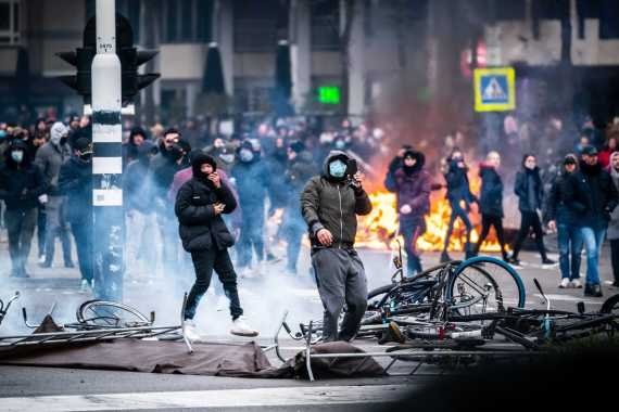 Fighting between police and protesters erupted last weekend as hundreds demonstrated against coronavirus restrictions in Eindhoven. Netherlands Prime Minister Mark Rutte told reporters the street violence was 'unacceptable'. [Rob Engelaar/EPA]