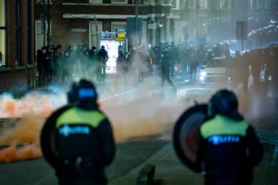 Demonstrators clash with police in Rotterdam. [Killian Lindenburg/MediaTV via EPA]