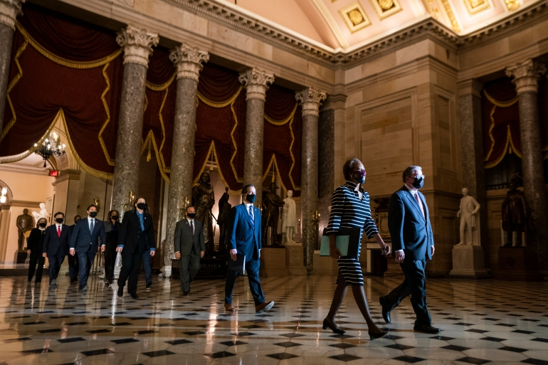 House impeachment managers arrive to deliver an article of impeachment against former President Donald Trump to the Senate for trial on accusations of inciting the deadly January 6 attack on the Capitol [Jim Lo Scalzo/EPA]