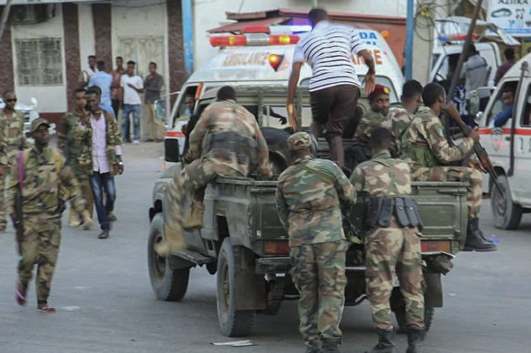 Somali military personnel arrive at the scene of a bomb explosion at the Afrik Hotel in Mogadishu [Said Yusuf Warsame/EPA]