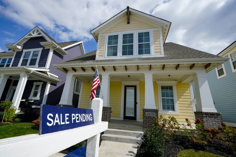 The recent spike in United States home prices reflects a boost in demand as Americans locked down during the coronavirus pandemic seek to move to larger homes [File: Michael Conroy/AP Photo]
