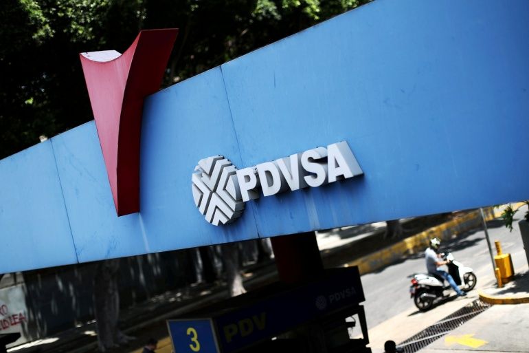 PDVSA's logo is seen at a gas station in Caracas, Venezuela, where President Nicolas Maduro is seeking to attract investments to the OPEC nation [File: Ivan Alvarado/Reuters]