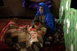 Akhtar Jan at her home in Zirkan village in Indian-administered Kashmir's Shopian district [Shuaib Bashir/Al Jazeera]