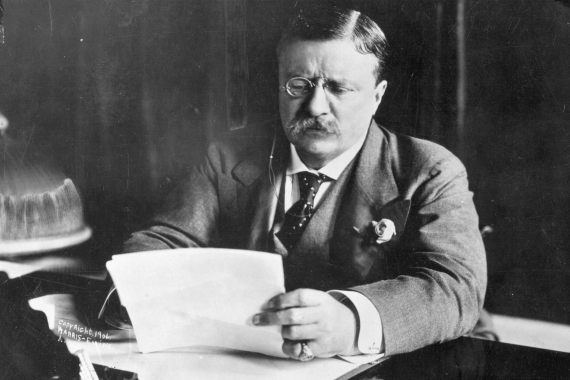 Circa 1905: Theodore Roosevelt (1858-1919), the 26th president of the United States (1901-09) sitting at his desk working [File: Hulton Archive/Getty Images]