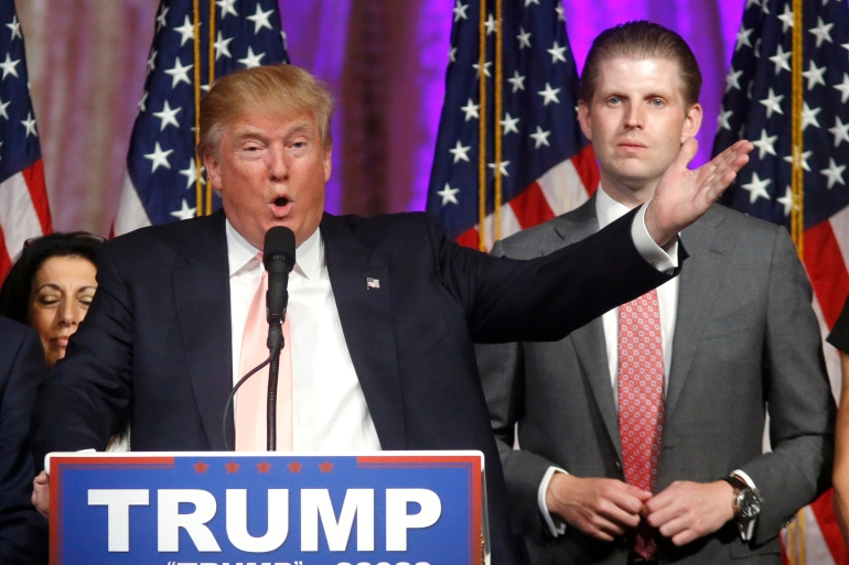 Eric Trump (right) dismissed the hits as no big threat to a company that has minimal debt – $400m against billions in assets – and can always tap its vast real estate holdings for cash, not to mention the allegiance of those sticking by the president [File: Gerald Herbert/AP Photo]