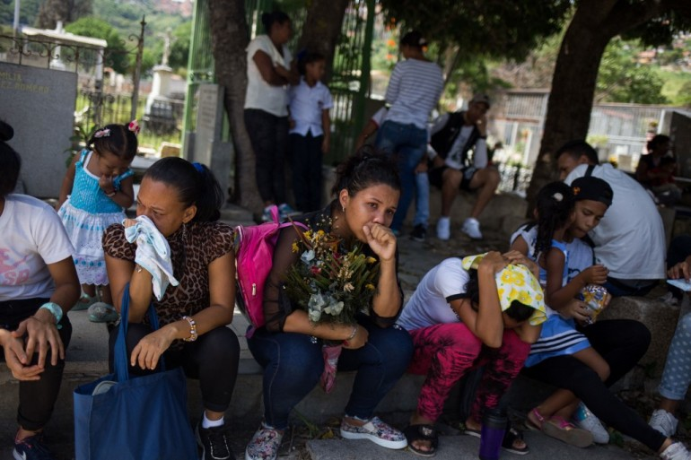 Maduro's government blames the sanctions for Venezuela's economic woes, but critics say the country's economic collapse began before that [Stringer/AFP]