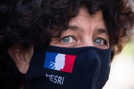 French Higher Education, Research and Innovation Minister Frederique Vidal, wearing a face mask reading MESRI, the French acronym for the ministry, answers journalists' questions at the end of a visit at the mask testing centre in Mulhouse on October 1, 2020 [Sebastien Bozon/AFP]