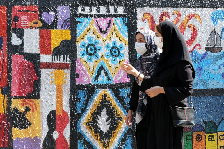 Iran has reported more than 1.9 million coronavirus cases since it announced its first case in February 2020 [File: Atta Kenare/AFP]