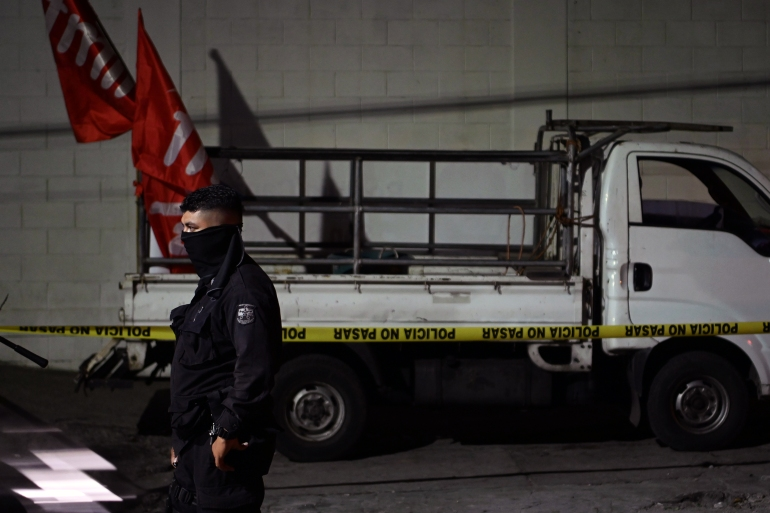 Police guard a truck that carried FMLN supporters, which was attacked in San Salvador on January 31 [Marvin Recinos/AFP]