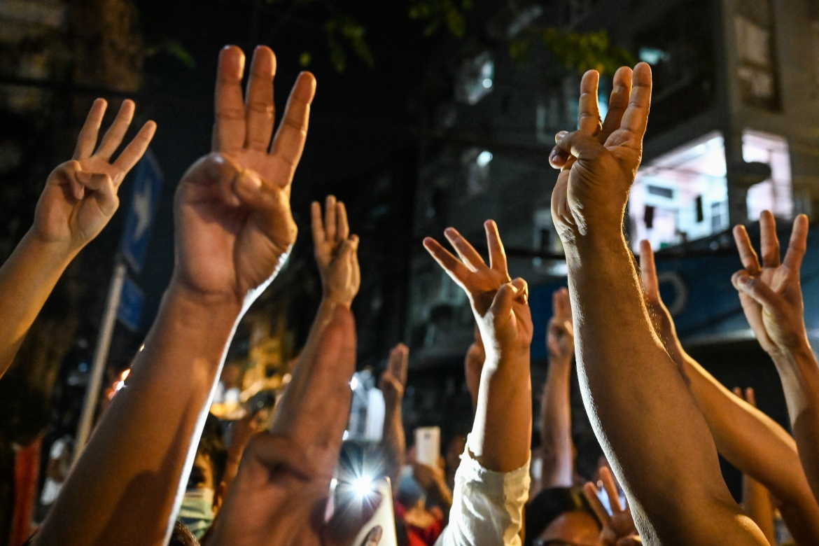People give a three-finger salute after calls for protests went out on social media in Yangon. [AFP]