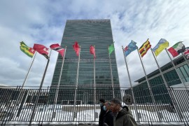 People walk front of the United Nations building in New York on February 3, 2021 [File: Daniel Slim/AFP]