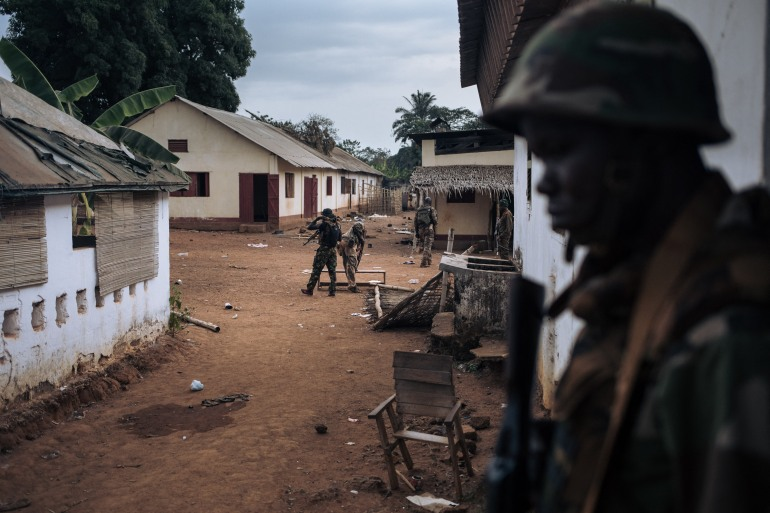 Central African Army soldiers inspect a looted military base in Bangassou that had been occupied by militiamen [File: Alexis Huguet/AFP]