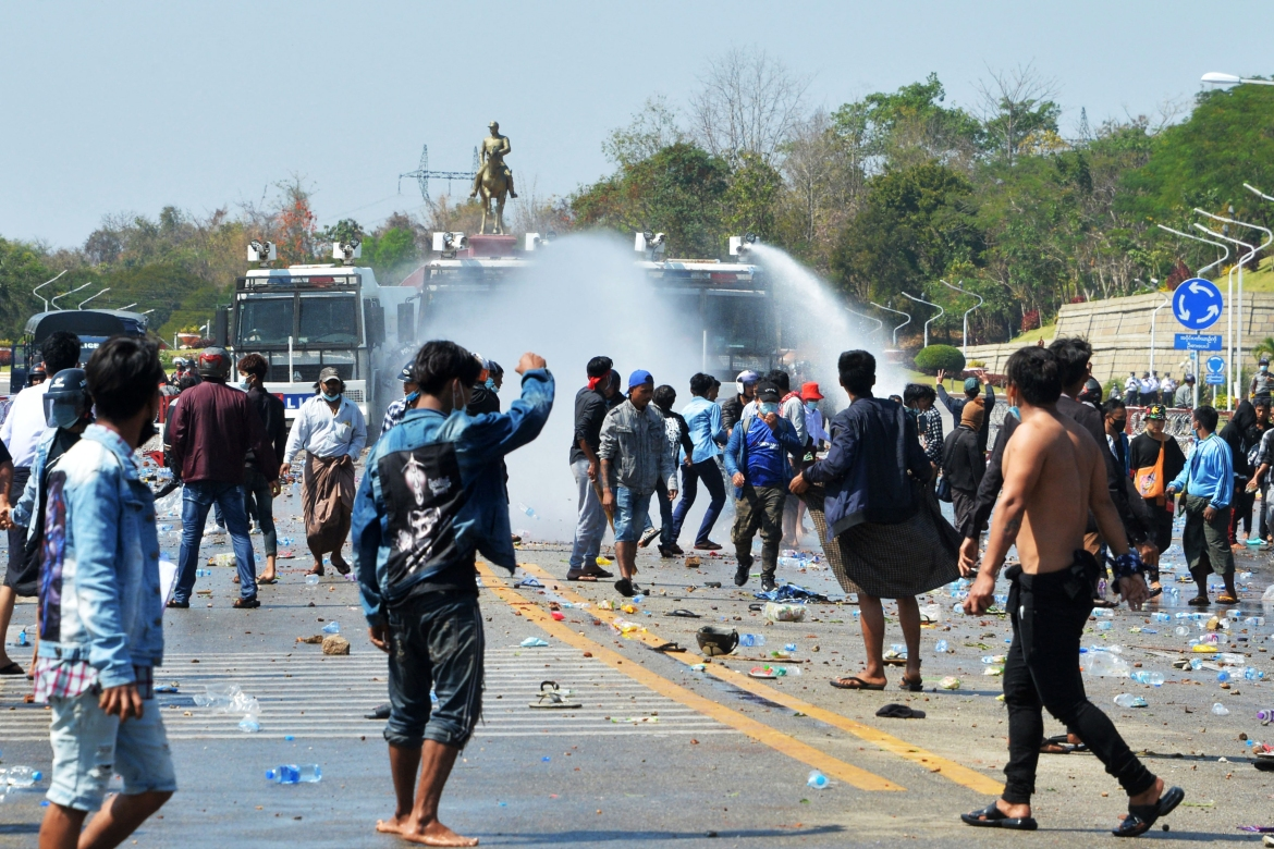 Police fire water cannons at protesters as they continue to demonstrate against the February 1 military coup in the capital Naypyidaw. [AFP]