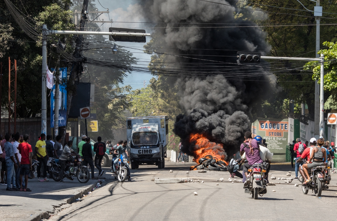 Tires set ablaze during the protests in Port-au-Prince. Wednesday's protest is the biggest one yet this year. [Valerie Baeriswyl/AFP]