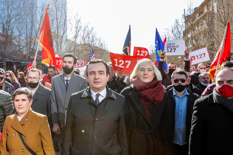Leader of the Movement for Self-Determination Albin Kurti, flanked by his wife, takes part in a rally on the last day of campaigning for the parliamentary elections in Pristina on February 12, 2021 [AFP/Stringer]